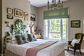 A floral-patterned headboard on a double bed in a Victorian home