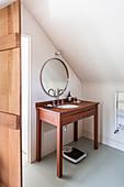 Teak washstand and round mirror in bathroom