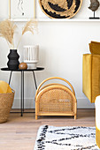 Rattan magazine rack in living room with yellow accents