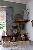 An old wooden box with a pair of vintage kitchen scales