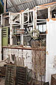 An old window and flea market items in a barn