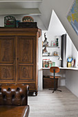 An antique wardrobe next to writing nook