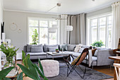 A blue-grey upholstered sofa in a bright living room