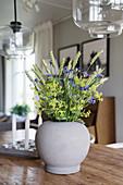 A bouquet of meadow flowers in an earthenware vase