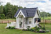 Scandinavian style playhouse in the garden