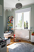 A view into a boy's room in shades of grey