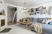 Gray upholstered sofa and coffee table in a Scandinavian living room