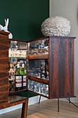 A sideboard as a bar cabinet with lighting and glass shelves