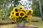 Sunflowers on table in garden