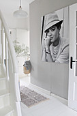 Black-and-white photo of Romy Schneider in grey and white hallway