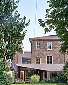 English brick house with modern extension and garden