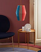 A DIY hanging lamp made of coloured wool