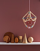 A DIY hanging lamp made from wooden beads
