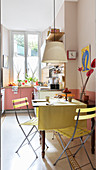 A table with garden chairs in a bright kitchen