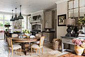 Spacious kitchen diner with limestone floor tiles and bespoke kitchen units