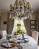 Elaborate chandelier and ornate table lamp