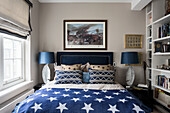 Nickel leaf table lamps with star bedspread and military artwork