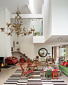 Spacious triple-height living space with gold paper chandelier