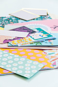 Construction paper with various printed patterns in pastel shades