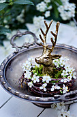 Golden stag head in wreath of twigs and blackthorn flowers
