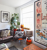 Fur blanket on easy chair and leather sofa in retro living room