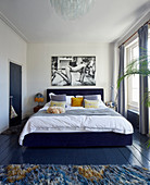 Black-and-white photo above bed in retro bedroom