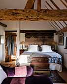 Antique suitcases with Victoran chaise longue in bedrom with main beam salvaged from an 16th century ship