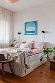 A double bed in a bright bedroom