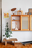 A wall shelf with a television behind sliding doors