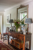 Antique wooden sideboard and lamps