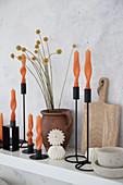 Arrangement of artistically twisted orange candles
