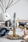 Arrangement of artistically twisted and curved candles on table
