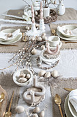 Artistically twisted and curved candles on table set for Easter meal