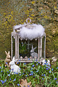 Easter bunnies and alpine squill, Easter bunnies and grape hyacinths in the glass shrine