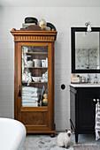 Antique linen cupboard in bathroom