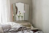 Three-piece antique wall mirror in the bedroom