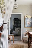 View through nursery into rustic living room