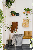 Hallway with houseplants and yellow accents