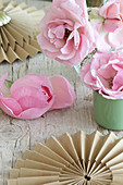 Romantic arrangement of roses and brown paper rosettes