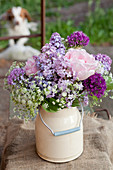 Spring bouquet of lilac, alliums, cow parsley and roses