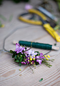 Spring wreath: tie hyacinth florets, waxflowers, mimosa and box onto wire ring using florists' wire