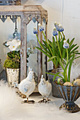 Easter decoration with grape hyacinths, horned violets, chickens, and Easter eggs