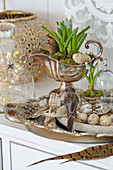Easter decoration with a bird figure, eggs, and grape hyacinth