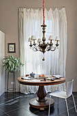 Ornate chandelier above round antique table