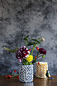 Autumn flowers in vases handmade from braided modelling clay