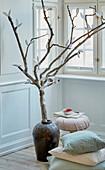 Spring tree with DIY paper leaves in floor vase