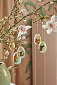 Easter eggs hung from magnolia branches