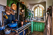 Rural kitchen with hanging copper pans