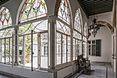 Arched, stained-glass windows overlooking courtyard of Oriental palace
