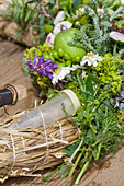 Incorporating florists' water vials into summer wreath